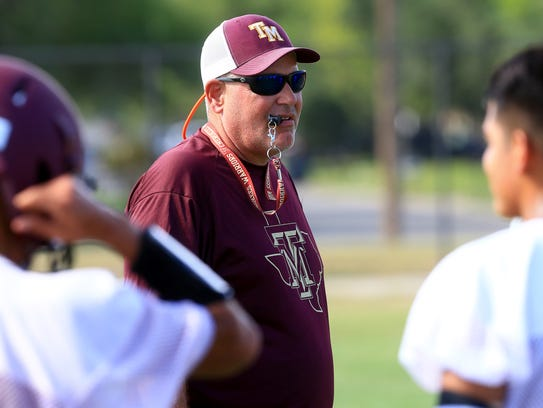 Tuloso-Midway's head coach Wade Miller talks to his