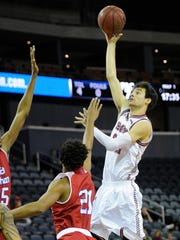 Bellarmine forward Adam Eberhard (22) shoots over Florida Southern forward Andre Elam (21) and Florida Southern forward Jarel Spellman (25) during the Small College Basketball Hall of Fame Classic at the Ford Center in Evansville, Saturday, Nov. 19, 2016.