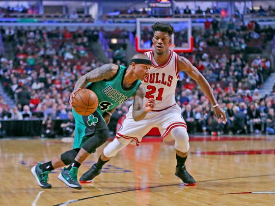 Isaiah Thomas drives past Jimmy Butler during the first