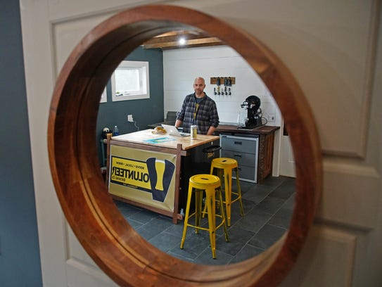 Kevin Schatz sits in Volunteer Brewing Company in Middletown, which he opened in August with a mission that includes volunteerism.