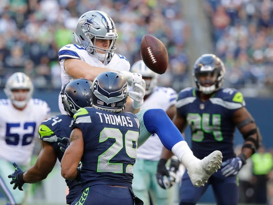 what went wrong for the dallas cowboys in their loss at seattle