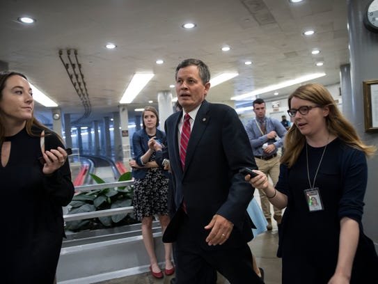 Sen. Steve Daines talks to reporters on Capitol Hill