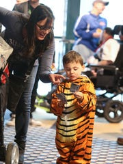 Tigers fans Bridget Antonelli and Miro Long, 3, wait