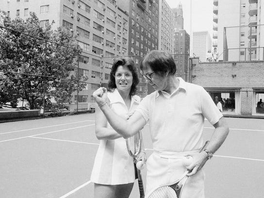 """FILE - In this July 11, 1973 file photo, Wimbledon champion Billie Jean King checks the muscle on her nemesis, Bobby Riggs, in New York.  The story of the early days of the tour and King's fight for equal prize money is chronicled in the movie """"Battle of the Sexes,"""" which opened nationwide on Friday, Sept. 29, 2017.  (AP Photo/Anthony Camerano, File)"""