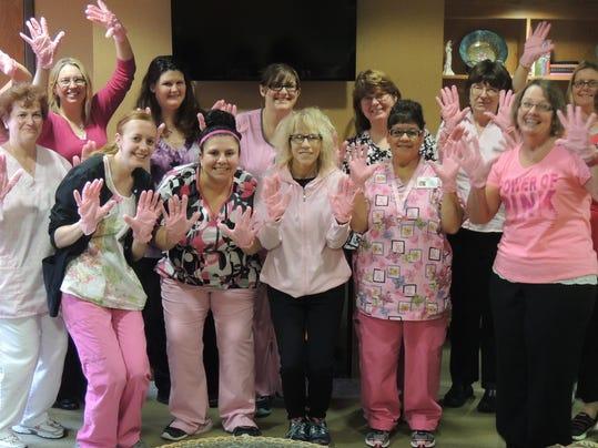 LHHS staff pink gloves.jpg