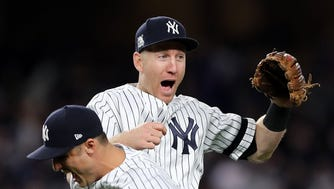 The Yankees' Todd Frazier celebrates with Greg Bird during the ALCS against the Houston Astros.