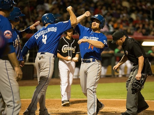 Las Vegas 51's first baseman and former El Paso Chihuahuas player, Brooks Conrad (14) celebrates with teammates after hitting a grand slam in the 5th inning against the Chihuahuas at Southwest University Park, Saturday, May 9, 2015, in El Paso. Photo by Ivan Pierre Aguirre