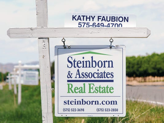Robin Zielinski   Sun-NewsA line of Steinborn & Associates Real Estate signs are posted along Highway 185 near Apache Canyon Court on Tuesday.