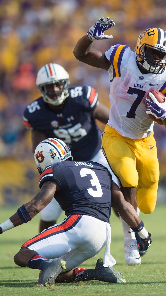 Louisiana State running back Leonard Fournette brake a tackle attempt by Auburn Tigers defensive back Jonathan Jones (3) during the NCAA football game between LSU Tigers and Auburn on Saturday, Sept. 19, 2015, at Tiger Stadium in Baton Rouge, La. 