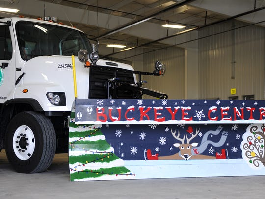 A Buckeye Central themed snow plow sits in the new