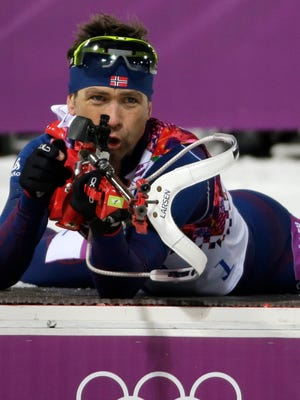 Norway's Ole Einar Bjoerndalen finishes the first round of shooting during the men's biathlon 12.5k pursuit.