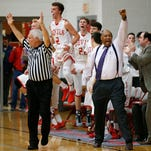 Head coach David Wood, center and the West Lafayette bench erupt after a Red Devil three-point basket against Central Catholic Friday, February 12, 2016, in West Lafayette. West Lafayette defeated their cross town rival 61-56.