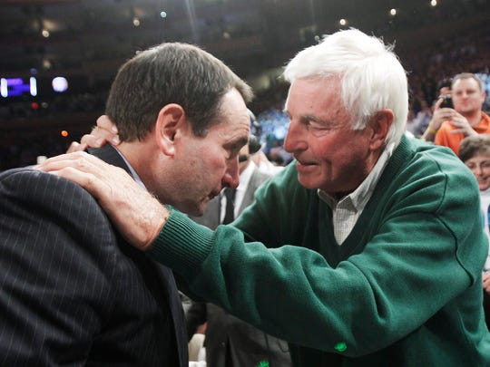 Duke coach Mike Krzyzewski has a moment with Bob Knight after Krzyzewski earned his 903rd victory in 2011, passing Knight for the most Division I victories.