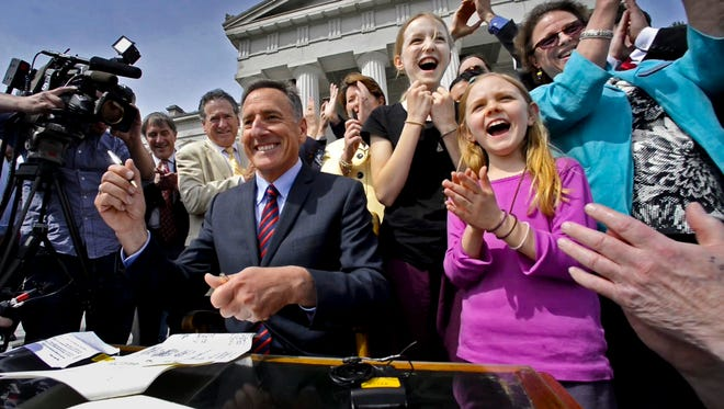 Gov. Peter Shumlin signs a bill requiring the labeling of food with GMO ingredients during a ceremony at the Statehouse in Montpelier on May 8.