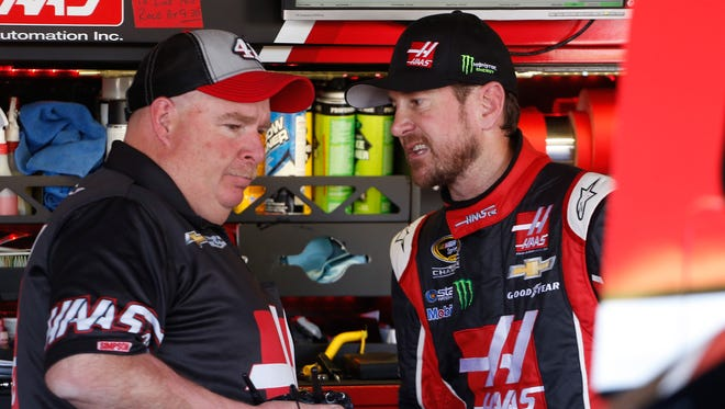 Crew chief Tony Gibson, talking in the garage with driver Kurt Busch, missed the Sprint Cup race at Bristol Motor Speedway because of kidney stones.