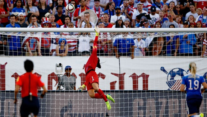 United States goalkeeper Hope Solo (1) makes a save against Sweden during the second half in a Group D soccer match in the 2015 FIFA women's World Cup at Winnipeg Stadium.