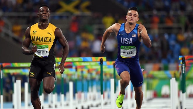 Aug 16, 2016; Rio de Janeiro, Brazil;  Devon Allen (USA) and Omar Mcleod (JAM) during the men's 110m hurdles semifinals in the Rio 2016 Summer Olympic Games at Estadio Olimpico Joao Havelange. Mandatory Credit: James Lang-USA TODAY Sports