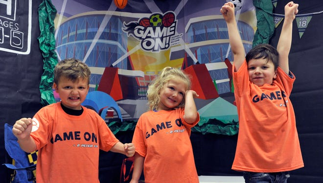 """Sam Whitten, 5, Camdyn Crouch, 4 and Maddox Stotts, 5, show their game faces for vacation Bible school at Pioneer Drive Baptist Church on May 22. """"Game On!"""" is this year's theme."""