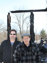 Mike (left) and Jim Harbert stand in front of the remains of the old Unadilla Store after it burned down in January 2015.