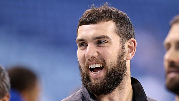 Indianapolis Colts quarterback Andrew Luck (12) shares a laugh with his teammates before the start of  their game. The Indianapolis Colts play the Houston Texans Sunday, December 20, 2015, afternoon at Lucas Oil Stadium.