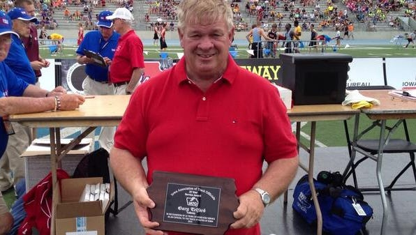 Former Ankeny High School Activities Director Gary Telford was honored for 25 years of service during the coed state track meet on May 24 at Drake Stadium. Telford passed away on Thursday at the age of 61.