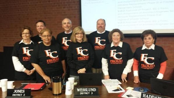 Jefferson County Board of Education members wear FC Proud shirts at the Oct. 13 board meeting.