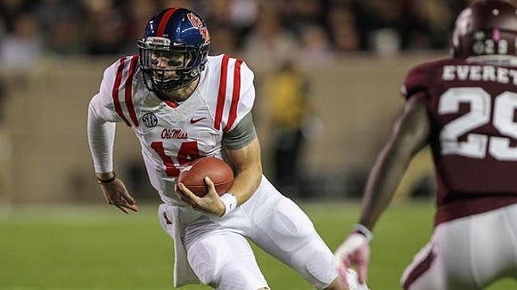 Bo Wallace and the No. 7 Ole Miss Rebels will try to rebound from last week's loss at LSU on Saturday against No. 4 Auburn