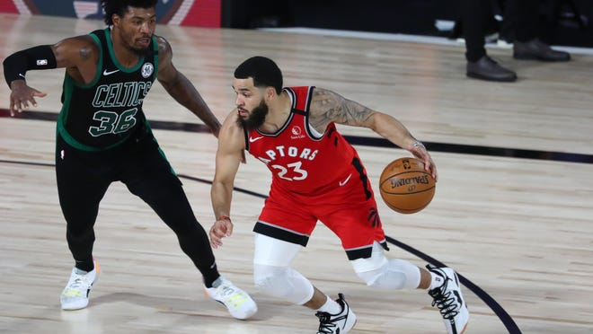 Toronto Raptors guard Fred VanVleet (23), shown dribbling against Boston Celtics guard Marcus Smart, is the most accomplished basketball player in Rockford history.
