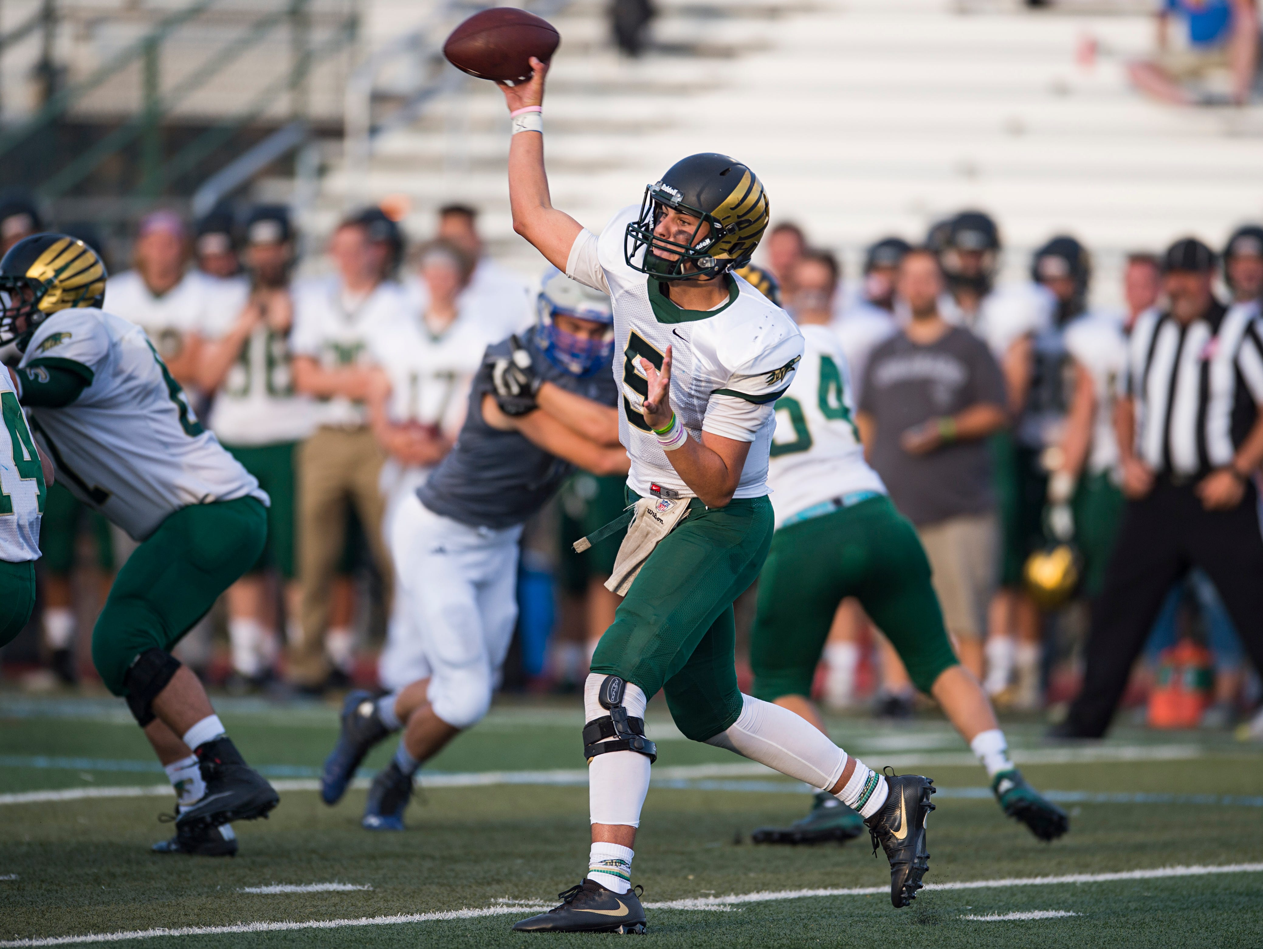 Mountain Vista quarterback Judd Erickson sends the ball to a receiver during a game against Poudre at French Field Thursday, September. The Golden Eagles quarterback stopped the Impalas with 450 yards and a 67-37 victory.