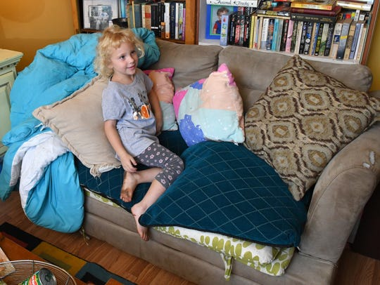 Zoe, 5, with The Couch. David Light and his wife Summer