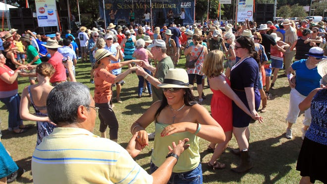 Festival-goers dance at Scene Mon Heritage at the 2014 Festivals Acadiens et Créoles in Girard Park.