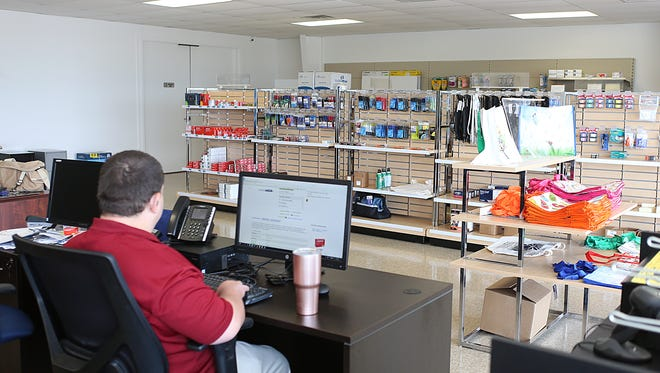 Employees work at the newly opened Lighthouse Office Supply, 1953 Austin St., operated by the West Texas Lighthouse for the Blind, on June 13, 2018.
