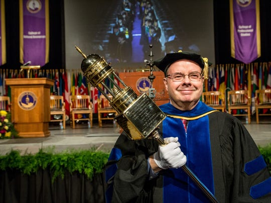 As grand marshal of the UW-Stevens Point winter commencement, Communication Professor Jim Haney led the procession of graduates and faculty into the Multi-Activity Center on Dec. 19.