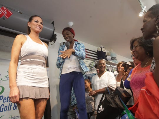 Second from left, Venus Williams, shows off her line of clothing during a display presentation with models at Pete Carlson's Golf and Tennis Shop in Palm Desert. Williams returns to the BNP after a 15-year absence.