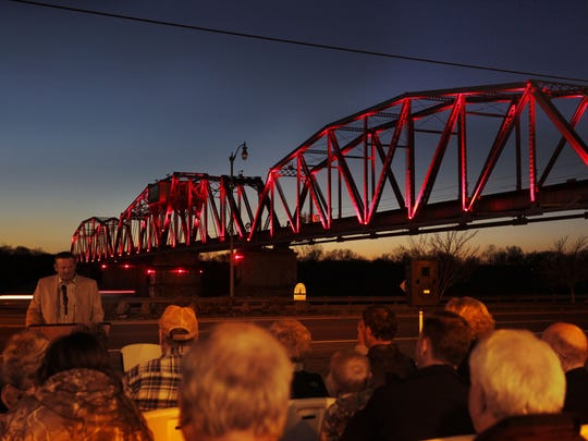 The RJ Corman railroad bridge will light up for the Stand up for Cancer event Friday.