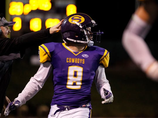 Salinas' Trevor Simon is congratulated after an interception during an CCS conference football game against Alvarez at Salinas High on Friday, October 28, 2016 in Salinas, Calif. Vernon McKnight/for The Californian