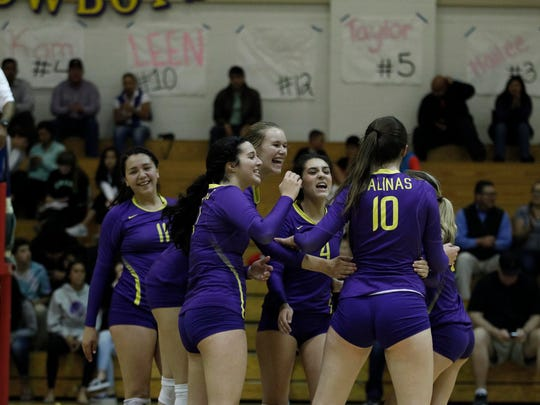 Salinas celebrates a score during an 2016 CIF Central Coast Section: Division 1 Girls Volleyball Tournament against Abraham Lincoln at Salinas High.