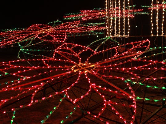 Lighted flowers shine along the banks of the Concho River as part of the Tour of Lights.