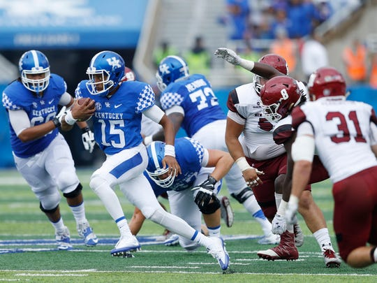 LEXINGTON, KY - SEPTEMBER 17: Stephen Johnson #15 of the Kentucky Wildcats runs for a nine-yard gain against the New Mexico State Aggies in the first half at Commonwealth Stadium on September 17, 2016 in Lexington, Kentucky. (Photo by Joe Robbins/Getty Images)