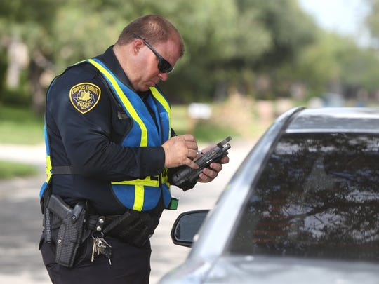 Corpus Christi Police Department Senior Officer Robert Cunningham tickets a driver for speeding in a school zone on Wooldridge Road in 2013.