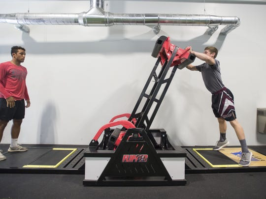Berthoud High School sophomore wrestler Brock Leypoldt, right, pushes over The Flipper to his exercise partner, Western State Colorado University and Poudre graduate Diego Calderon Thursday  during a class at Ironside Athletics.