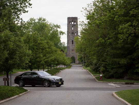 With Devil's Tower in the background, a car turns across
