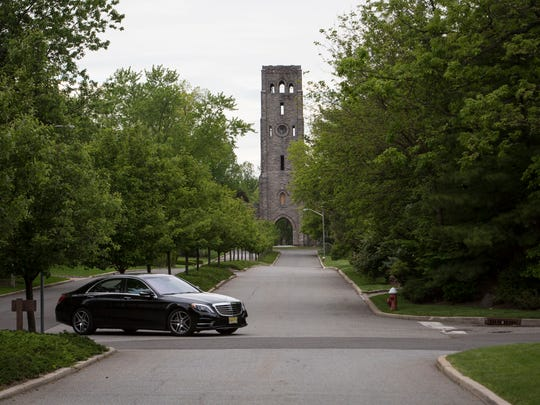 With Devil's Tower in the background, a car turns across The Esplanade in the Rio Vista section of Alpine.