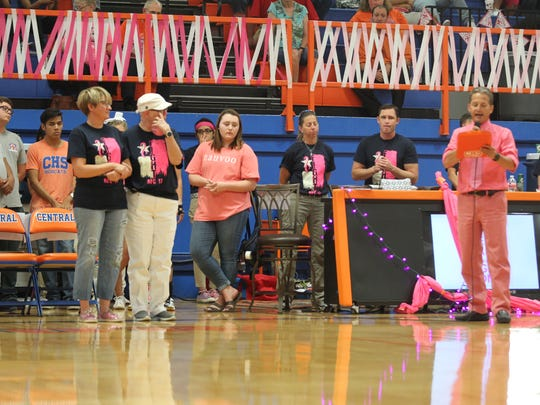 Central High School volleyball coach Connie Bozarth stands with an honorary captain Tuesday before the Lady Cats' annual Rally for a Cure match against Midland High at Babe Didrikson Gym. The event, which began in 2006, had raised nearly $140,000 for breast cancer research before this year's match. Bozarth was hoping to push past the $150,000 mark this year. For a recap of the event and the Lady Cats' match, visit gosanangelo.com.