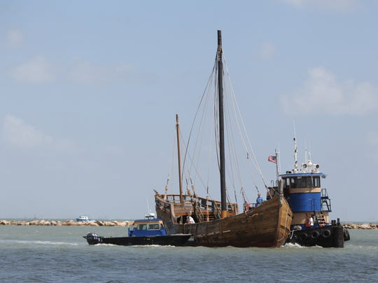 The last remaining Columbus Ship replica, La Nina, travels through Corpus Christi Bay on Friday, October 10, 2014 as it is prepared to be berthed at a new location at the Lawrence Street T-Head behind Joe's Crab Shack.