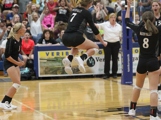 Water Valley's Kenzie Jordan (7) jumps up in celebration with teammates during the Lady Wildcats' 19-25, 25-19, 25-21, 25-18 District 7-2A win over Veribest at the Veribest gym on Saturday, Oct. 7, 2017.