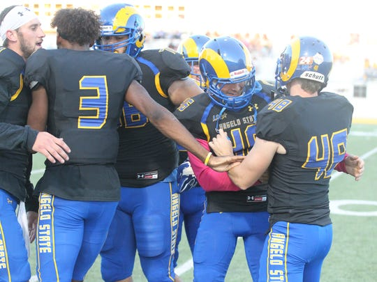 Teammates celebrate after Angelo State University's Connor Flanigan (48) kicked a 52-yard field goal during a Lone Star Conference game against Midwestern State at LeGrand Stadium at 1st Community Credit Union Field on Saturday, Oct. 14, 2017.