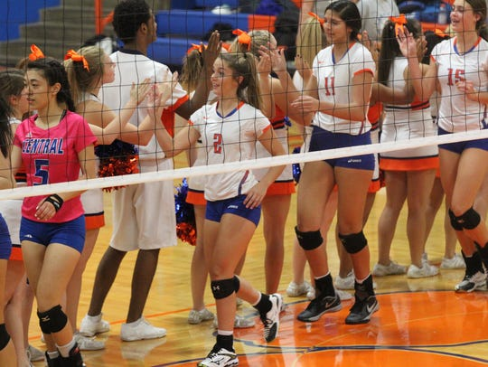 The Central High School volleyball team celebrates
