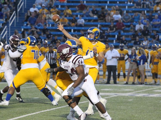 Angelo State University senior quarterback Jake Faber threw for 270 yards and four touchdowns and ran for another in a 51-3 win against West Texas A&M on Senior Day at LeGrand Stadium at 1st Community Credit Union Field on Saturday, Nov. 4, 2017.
