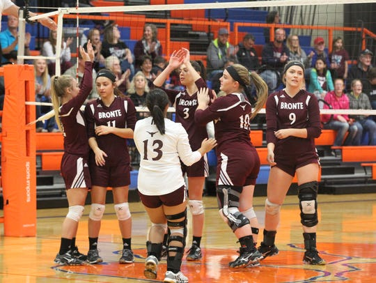 The Bronte High School volleyball team celebrates during